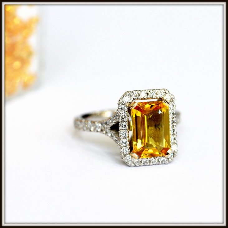 Emerald Cut Yellow Sapphire with Round Brilliant Cut Diamonds in Split Shank Halo Setting
