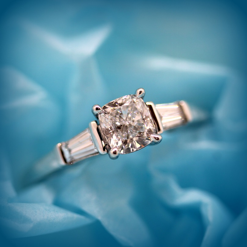 Cushion Cut Diamond with Tapered Baguette Cut Diamonds in a bar setting in 18ct White Gold Torres Jewel Co