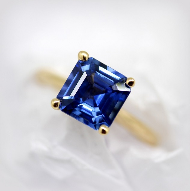 Radiant Cut Natural Blue Ceylon Sapphire in a four claw yellow gold setting Torres Jewel Co.