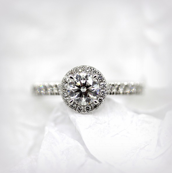 18ct White Gold Round Brilliant Cut Diamond ring with a Diamond halo and band. Torres Jewel Co